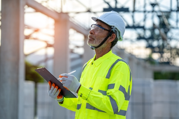 Engineer working about project in building construction site