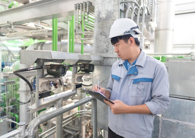 Engineer working and check valve at thermal power plant factory