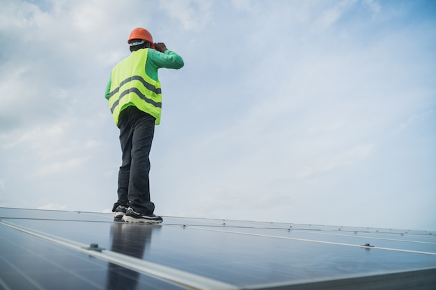 Engineer working on maintenance panel in solar power plant