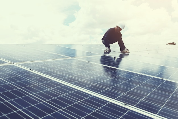 Engineer working on replacement solar panel in solar