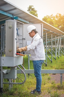Engineer works on monitoring and maintenance equipment: cheking status inverter