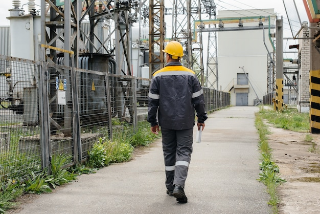 An engineering employee makes a tour and inspection of a modern electrical substation. energy. industry.