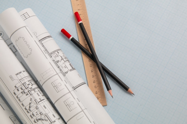Engineering house drawings, blueprints, ruler and pencils on graph paper