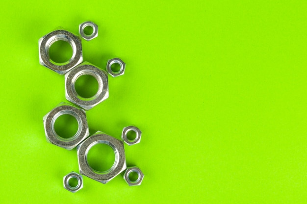 Engineering tools. bolts and nuts on color background