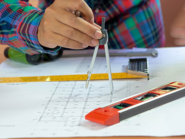 Engineering use equipment to make construction blueprint drawing
