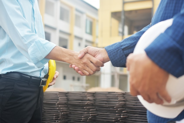 Engineers doing handshake