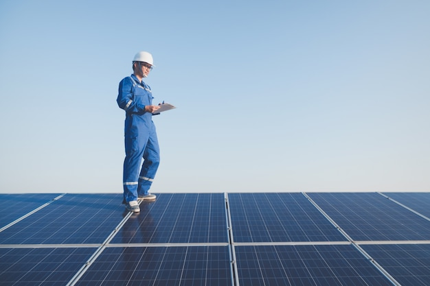Engineers operating and check generating power of solar power plant on solar rooftop