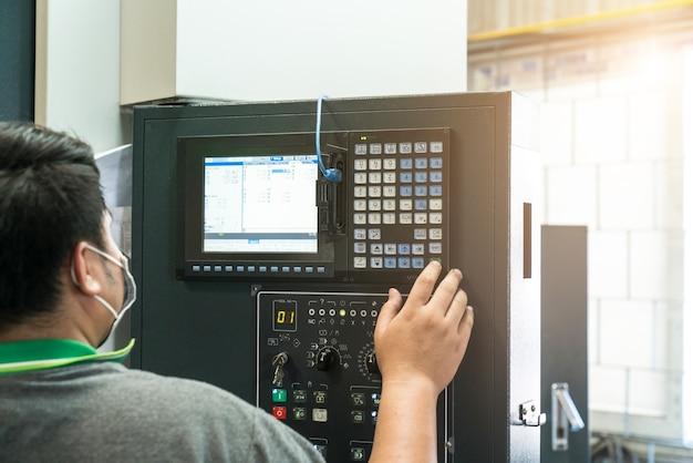 Engineers use computer lathe