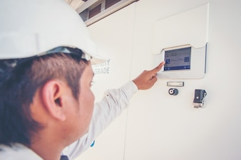 Engineers working on monitoring and maintenance of equipment at green power plants
