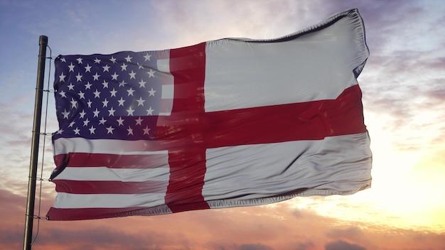 깃대에 영국과 미국 국기입니다. 바람에 물결 치는 미국 및 영국 국기