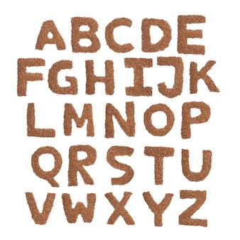 English alphabet from brown dry buckwheat on a white isolated