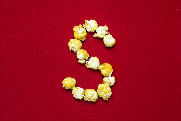 English alphabet from cinema popcorn, background, letter s