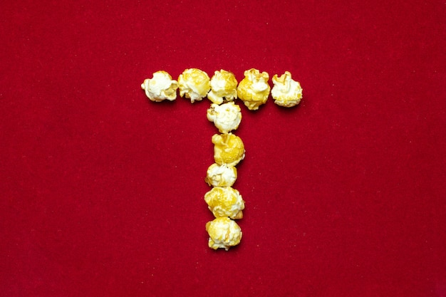 English alphabet from cinema popcorn. letter t.