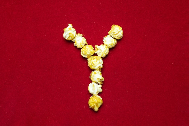 English alphabet from cinema popcorn. letter y. red background for design