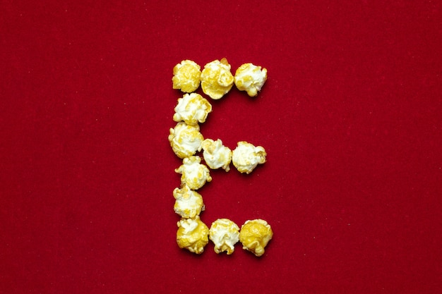 English alphabet from cinema popcorn with  letter e