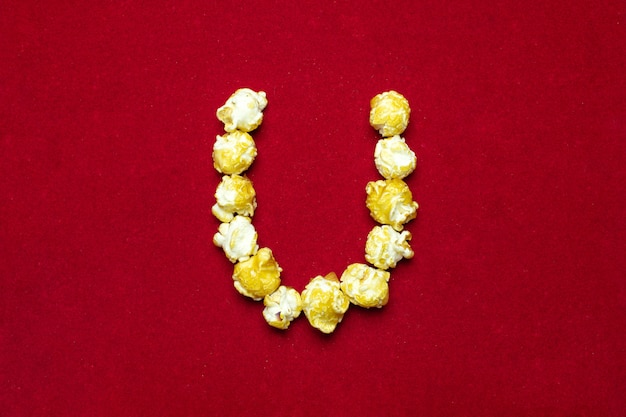 English alphabet from cinema popcorn with  letter u