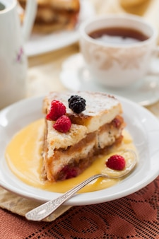 English bread and butter pudding with apples and cranberries