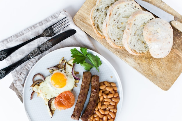 English breakfast on a grey plate on a white background.
