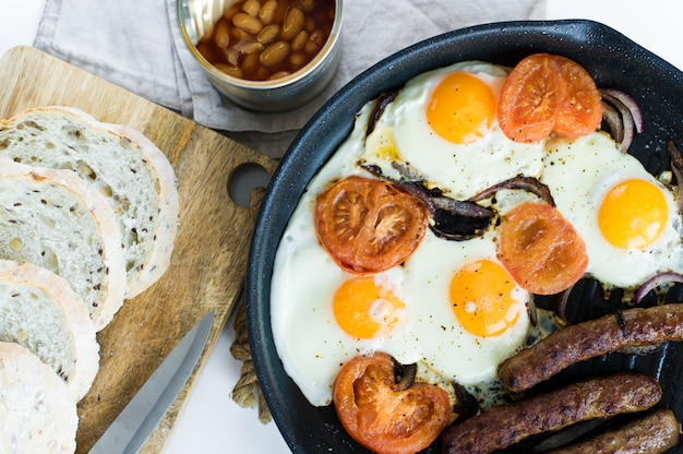 English breakfast in a pan on a white background.