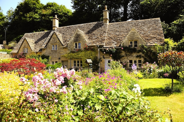 English country cottage in the sunshine in cotswold, england, uk
