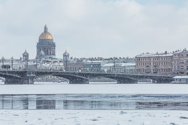 English embankment lieutenant shmidt bridge and st isaacs cathedral in saint petersburg russia