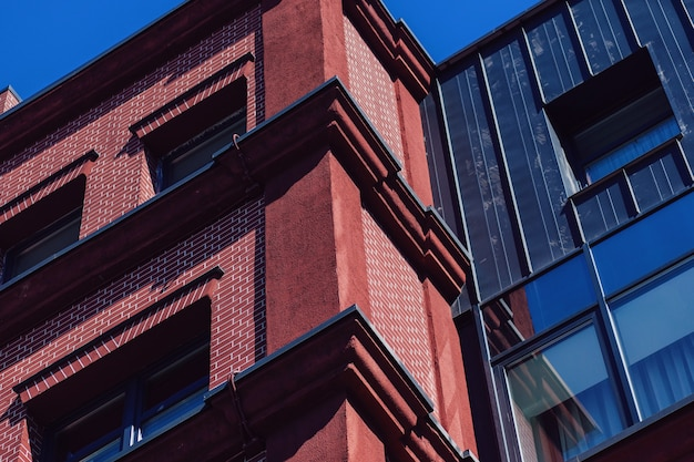 English houses made of red brick against a blue sky. business real estate