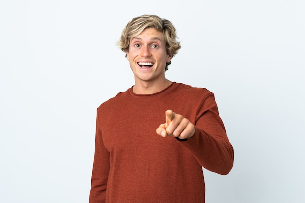 English man over isolated white background surprised and pointing front
