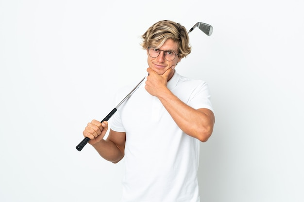 English man playing golf thinking