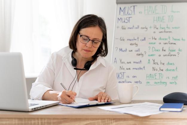 English teacher doing her lessons online