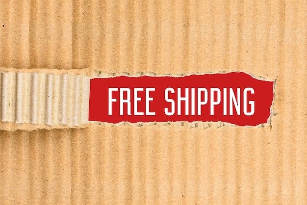 English text free shipping on a red paper, revealed by a torn cardboard.