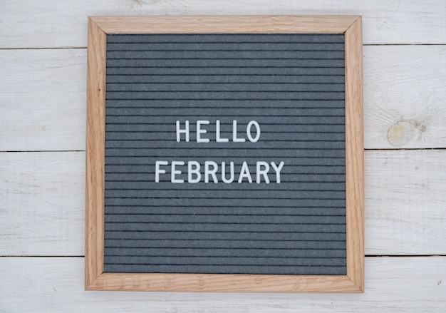 English text hello february on a letter board in white letters