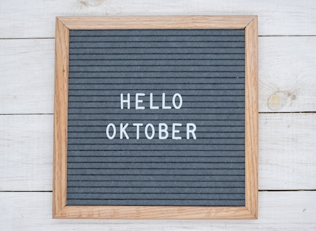 English text hello october on a letter board in white letters