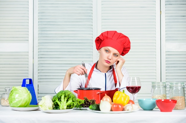 Enjoy easy ideas for dinner. woman enjoy cooking food. housekeeping and culinary. housewife prepare meal with wine. housewife daily routine. girl adorable chef. housewife cooking and drink wine.