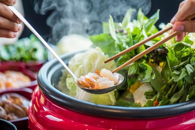 Enjoy eating shabu shabu and sukiyaki in hot pot at japanese restaurant