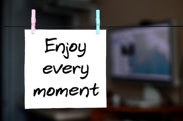 Enjoy every moment. note is written on a white sticker that