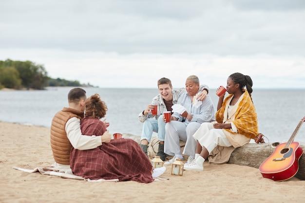 Enjoying beach party in autumn