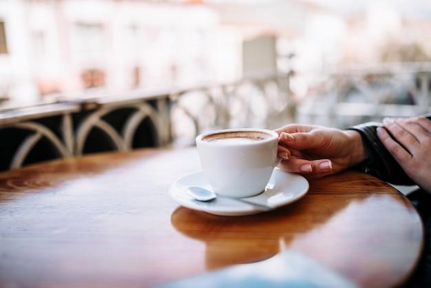 Enjoying cup of coffee on the balcony.