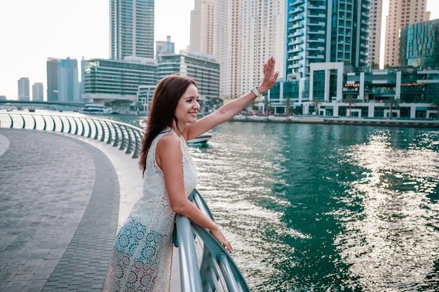 Enjoying travel in united arabian emirates. happy woman