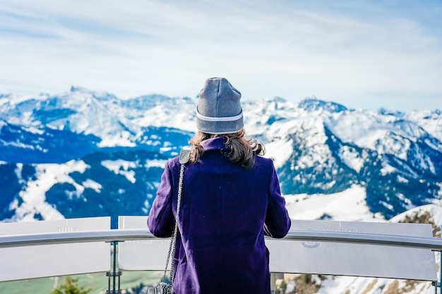 Enjoying travel. young woman traveling looking out the view from mt. stanserhorn in switzerland