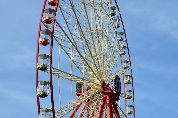 Entertainment ferris wheel against the clear blue sky