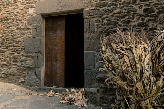 Entrance of a classic mill where corn cobs waiting their turn to be ground