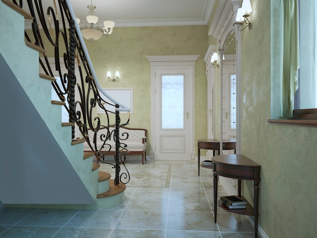Entrance hall classic style with stairs with light olive color walls of textured plaster and furniture of mahogany and marble tile flooring.