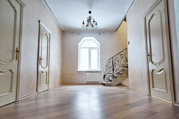 Entrance hallway with staircase. viewsteps with wrought iron railings