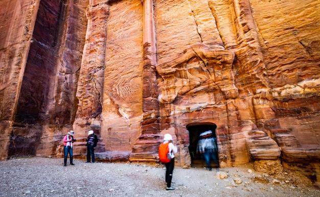 Entrance in rock cave petra, jordan