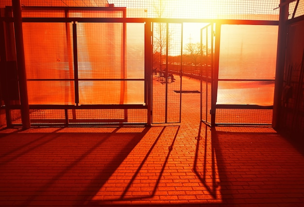 Entrance with dramatic sunset light rays city background