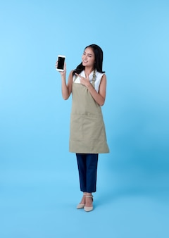 Entrepreneur asian woman using smartphone on blue.