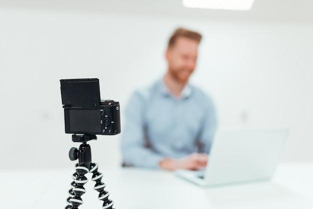 Entrepreneur blogger filming himself in office.