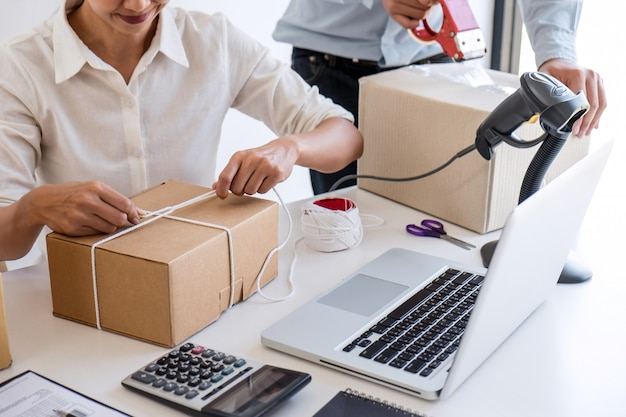 Entrepreneur owner delivery service, business owner working checking order to confirm before sending