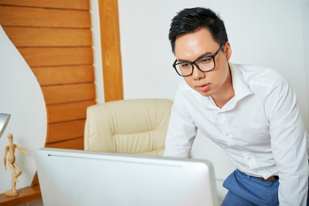 Entrepreneur reading data on computer screen