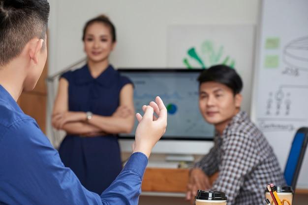 Entrepreneur talking to coworkers